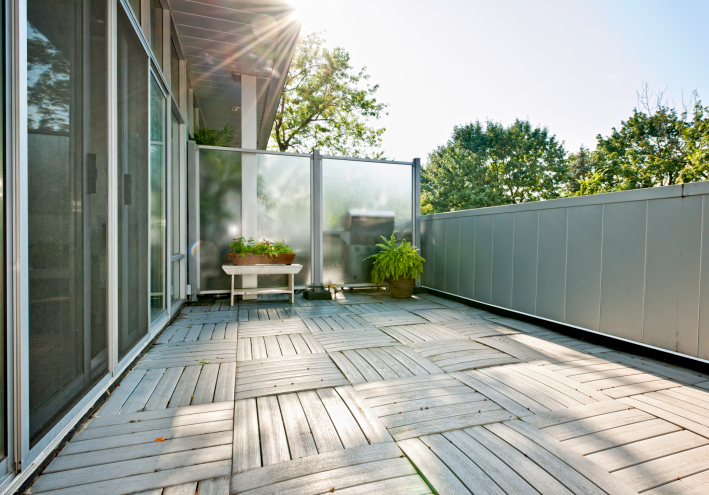 Small fenced-in deck/courtyard with checkered deck-floor design