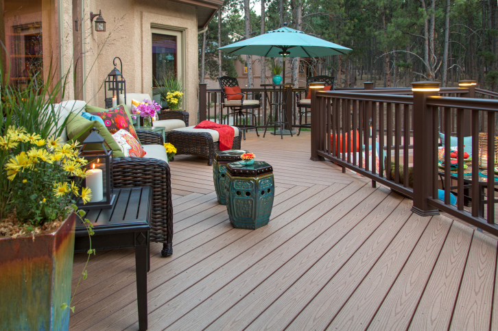 Expansive wood deck with low wood railing using diagonal wood floor design