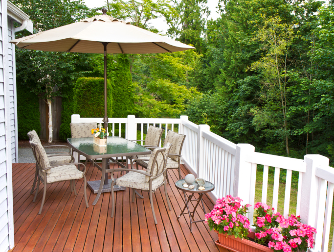 Elegant natural wood deck with white wood railing