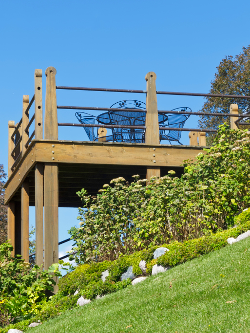 Pictures Of Sundecks Stairs And Benches: Sturdy Deck Built On Steeply Sloping Hillside With Wood