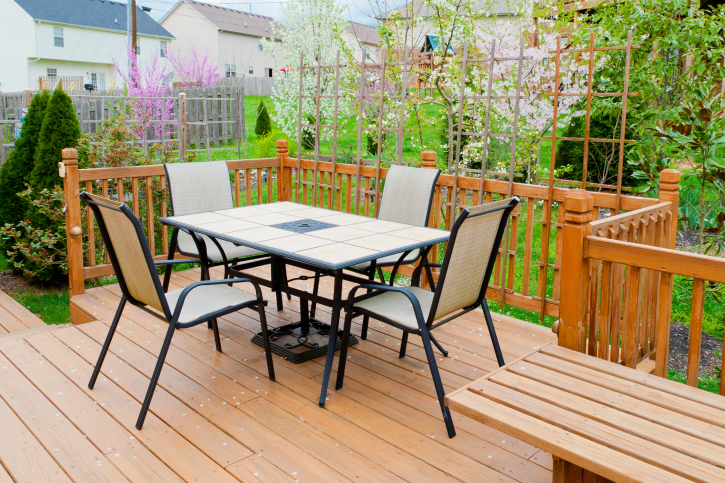 Basic wood deck with ornate wood railing with trellis