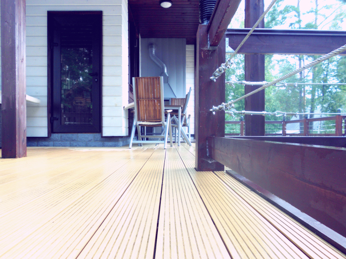 Picture of deck with wood and cable railing (chose this photo to show a railing made in part with cables which looks very cool