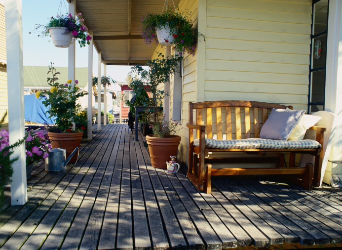 Large wrap-around covered veranda deck with no railing