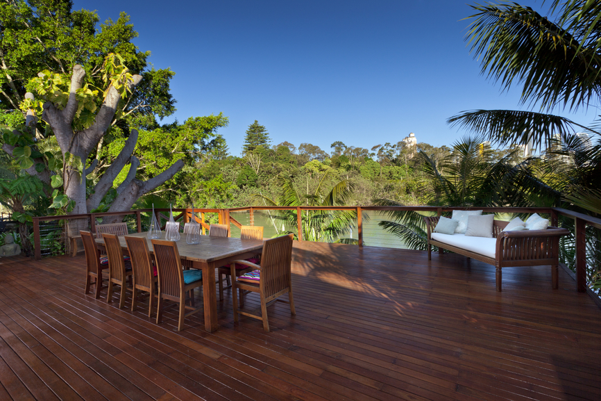 Huge wooden deck with large dining table and sofa