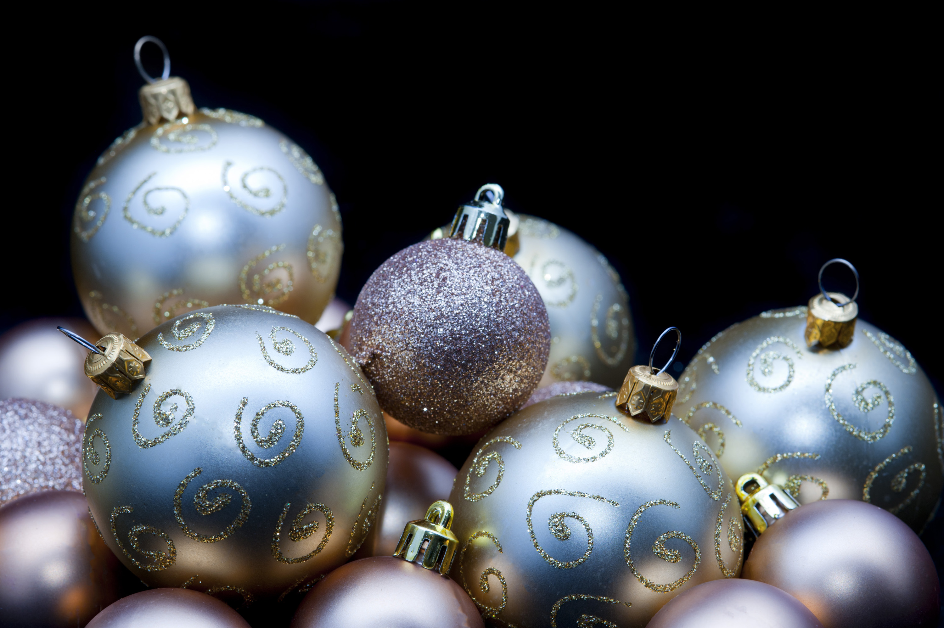 an assortment of glitering christmas baubles