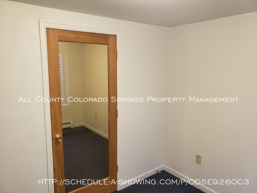 View_of_door_separating_2_ll_rooms