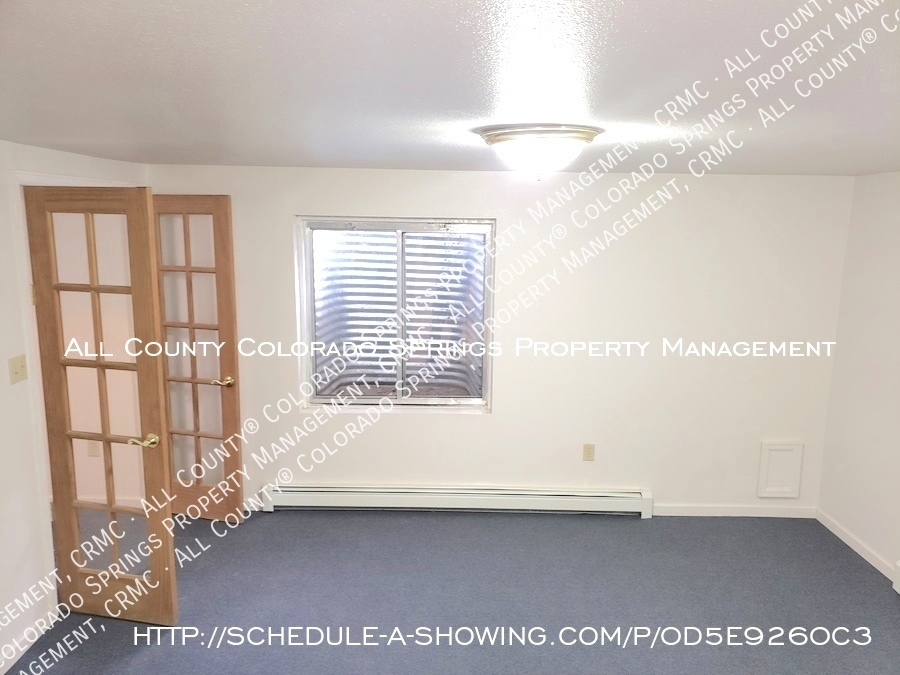 Peaceful_country_home_for_rent__close_to_schriever_air_force_base-room_at_base_of_stairs