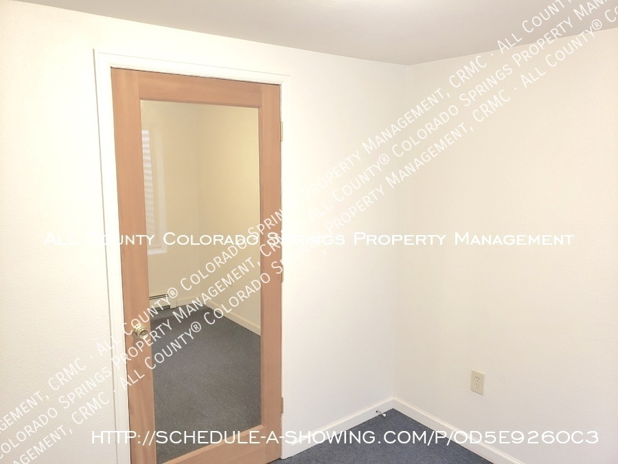Peaceful_country_home_for_rent__close_to_schriever_air_force_base-view_of_door_separating_2_ll_rooms