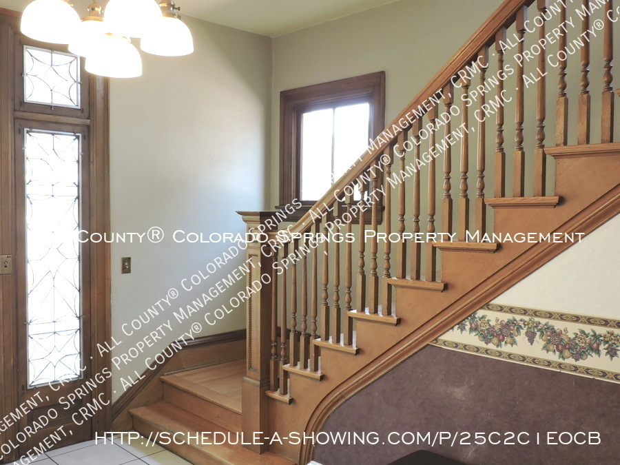 Downtown_studio_apartment_for_rent_in_victorian_home_near_colorado_college_cc-main_staircase
