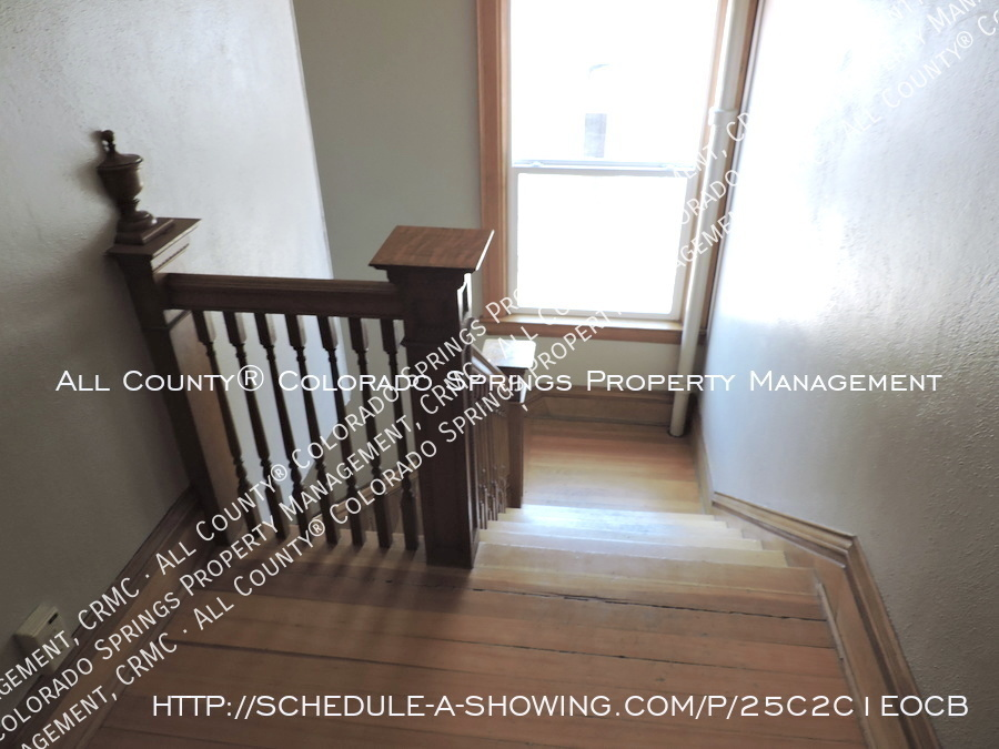Downtown_studio_apartment_for_rent_in_victorian_home_near_colorado_college_cc-back_staircase2