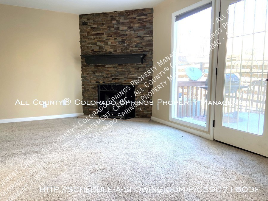 3-bedroom_townhome_for_rent_near_mountains_and_cheyenne_mountain_air_force_station-living_room_fireplace