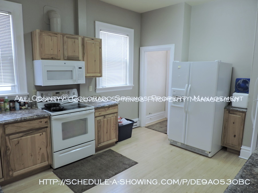 Room for rent downtown in quaint old house near colorado college cc main kitchen 2