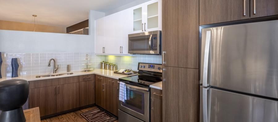 3 post south lamar 1br model phase 2 kitchen 1200x525 min