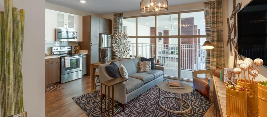 4 post south lamar 1rb model phase 2 living room 1200x525 min