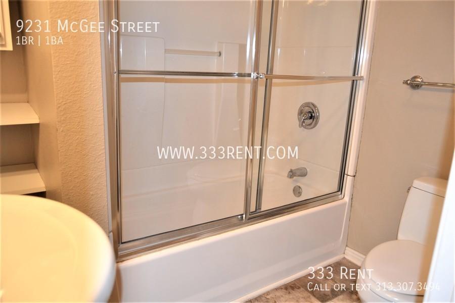 5.full bathroom with shelving
