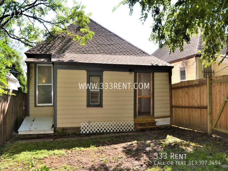 18back of house with privacy fence