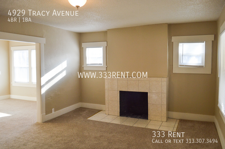 1front room with decorative fireplace