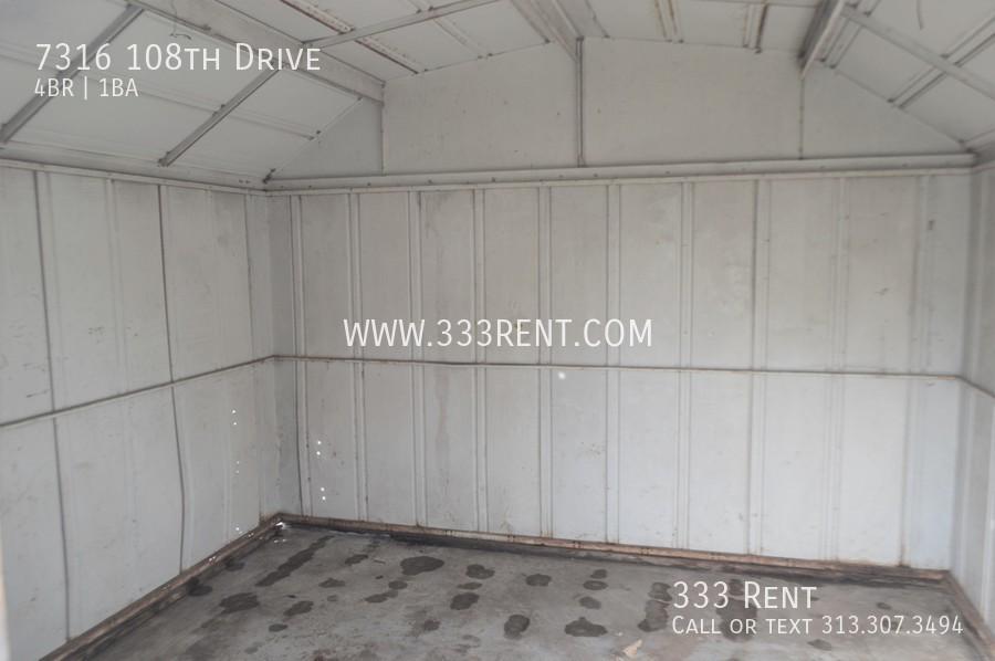 10storage shed in back yard