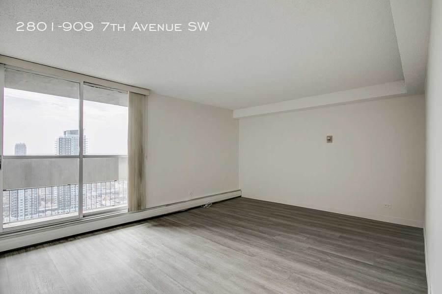 Grey living room with balcony