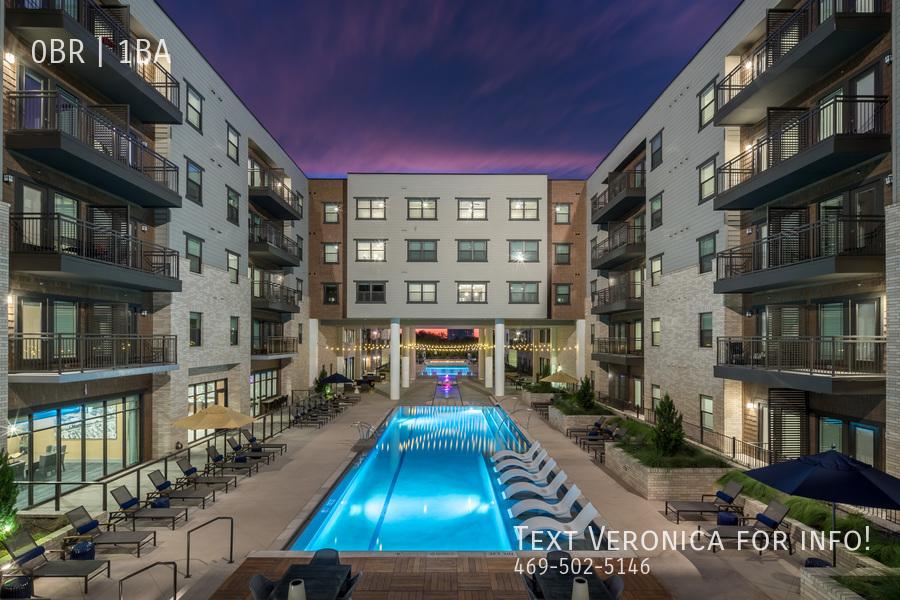 Alexan lower greenville pool at night tcra 4161 728