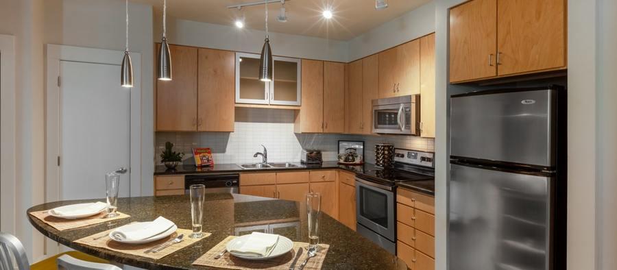 3 post south lamar 2br model phase 1 kitchen 1200x525 min