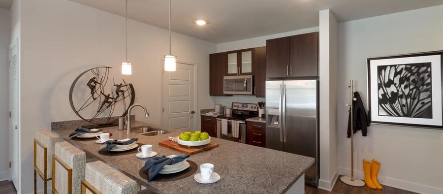 3 post south lamar 2br model phase 2 kitchen 1200x525 min