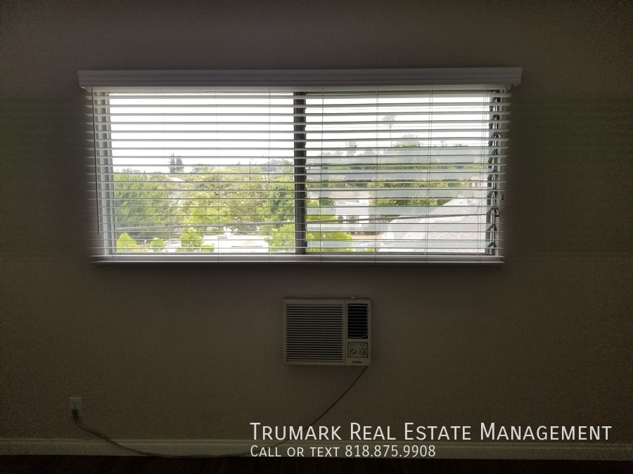 17 bedroom window and ac in wall