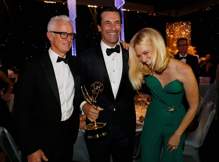 January Jones laughs as she poses for photos with Jon Hamm, centre, and John Slattery, at the 67th Emmy Awards in LA Photograph: Mario AnzuoniReuters