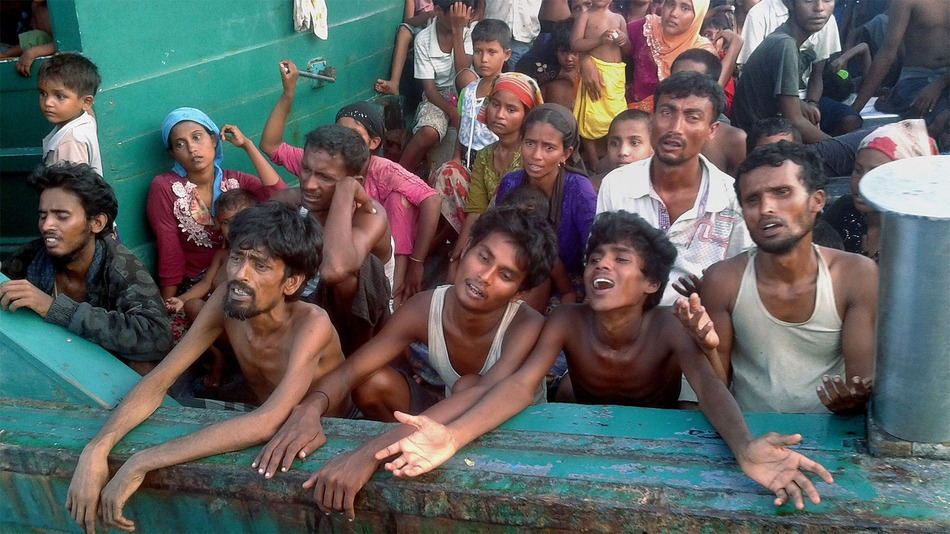 Rohingya migrants are pictured on a boat off the southern Thai island of Koh Lipe in the Andaman Sea on May 14, 2015 The boat crammed with scores of Rohingya migrants -- including many young children -- was found drifting in Thai waters