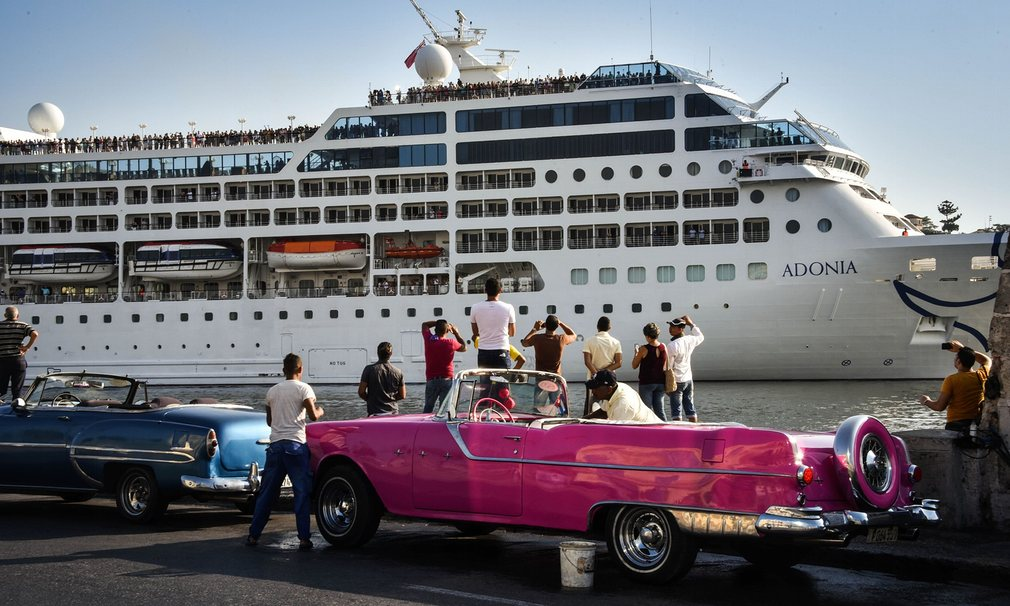 People watch as the first US-to-Cuba cruise ship to arrive in the island nation in decades glides into the port of Havana The ship set sail from Florida marking a new milestone in the rapprochement between Washington and Havana Photograph: