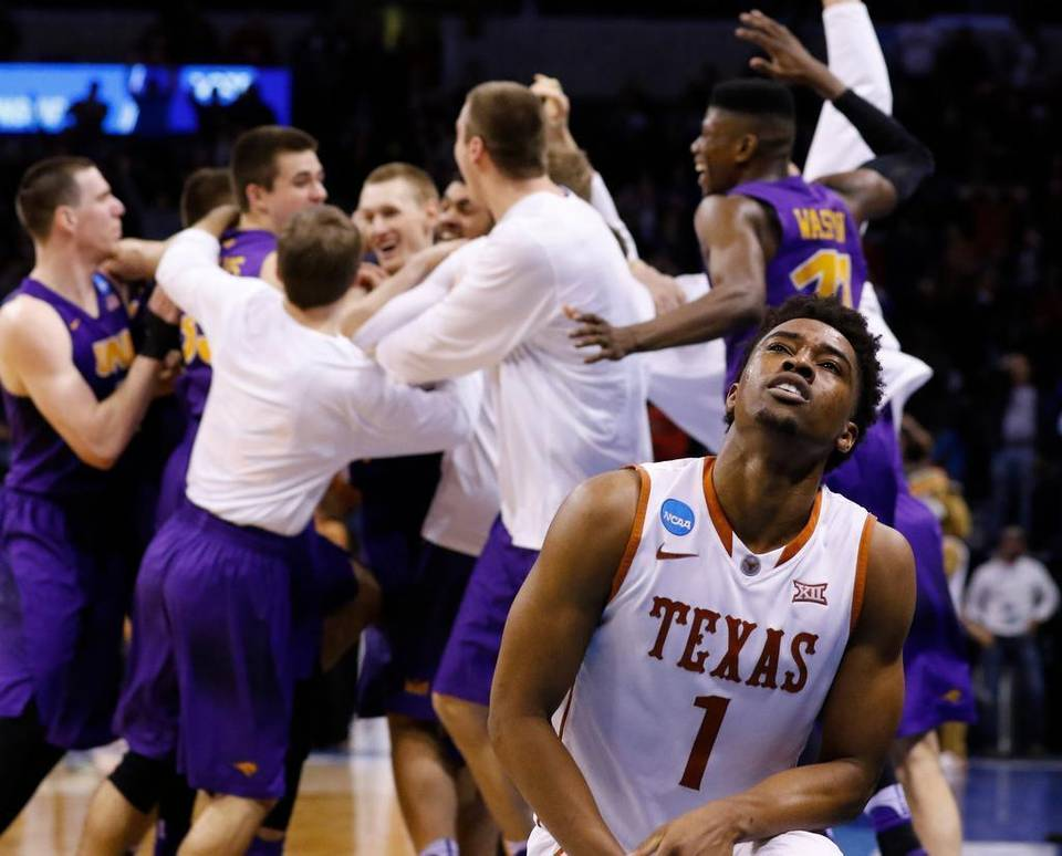 Texas guard Isaiah Taylor reacts as the Northern Iowa team celebrates after guard Paul Jesperson made a buzzer-beating half-court shot to win the the first-round NCAA Tournament game in Oklahoma City on Friday Alonzo Adams AP