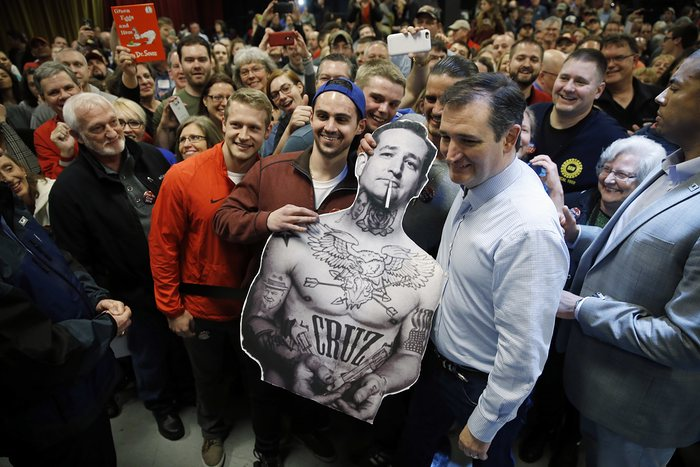 Republican presidential candidate Ted Cruz poses for photographs during a campaign stop Photograph: Matt RourkeAP