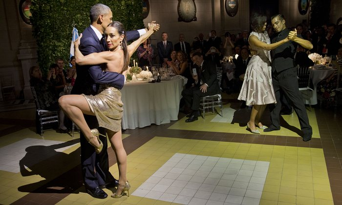 President Barack Obama and first lady Michelle Obama dance the tango during the state dinner at the Centro Cultural Kirchner Photograph: Pablo Martinez MonsivaisAP
