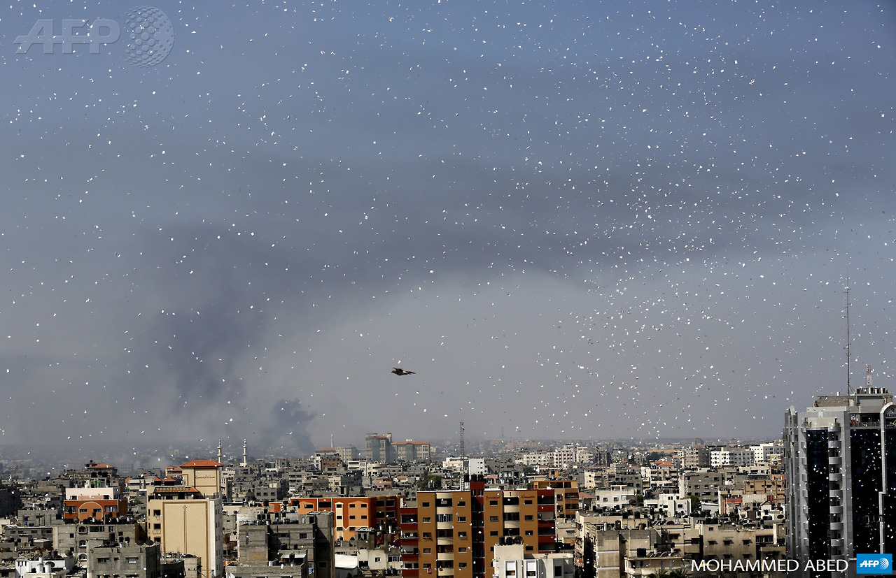 Flyers are dropped over Gaza City by the Israeli army urging residents to evacuate their homes on July 30, 2014 (Mohammed AbedAFPGetty Images)
