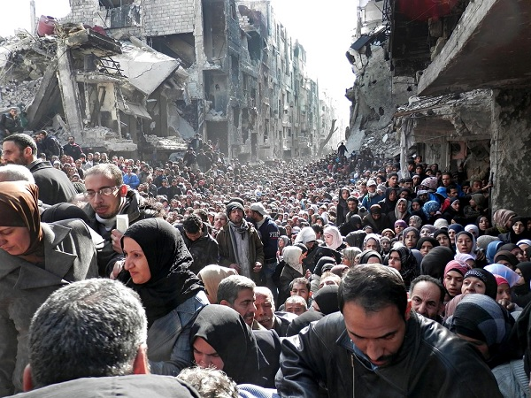 In a scene of unimaginable desolation – a crowd of men, women and children stand in line for aid at a UNRWA distribution point in the capital, Damascus, on 31 January