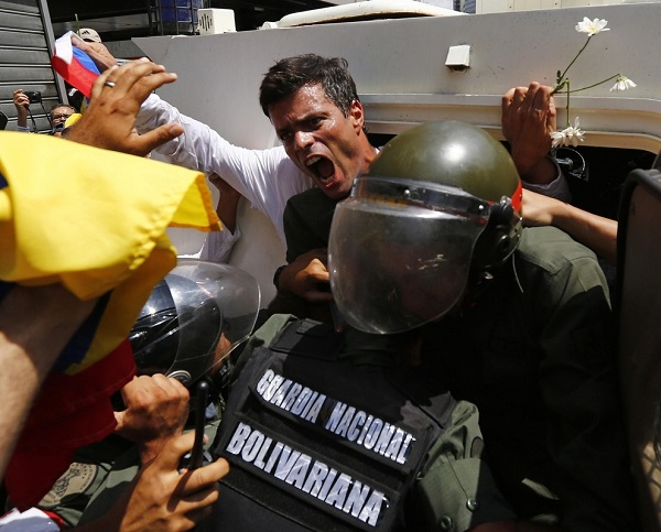 Venezuelan opposition leader Leopoldo López gets into a National Guard armored vehicle Lopez, wanted on charges of fomenting deadly violence, handed himself over to security forces