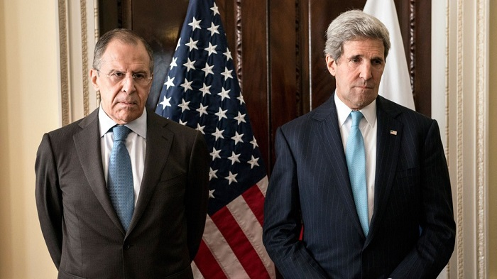 Russian Foreign Minister Sergey Lavrov, left, and US Secretary of State John Kerry stand together before a meeting at Winfield House in London, Friday March 14, 2014