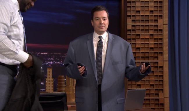 Jimmy Fallon tries on Shaquille ONeals enourmous suit jacket on The Tonight Show