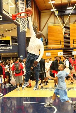 50 year old Michael Jordan dunks during his annual Flight School youth camp