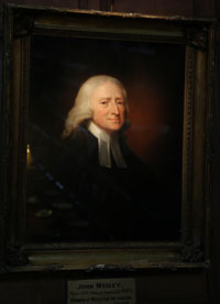 This oil portrait of the Rev. John Wesley hangs in the Great Hall at Christ Church Cathedral in London. Photo by Kathleen Barry, United Methodist Communications