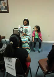 Felicia Finney reads to children at the festival.
