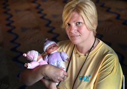 Karin VanZant holds two baby dolls used in poverty simulations conducted during the 2012 United Methodist General Conference in Tampa, Fla. VanZant is the national training coordinator for Circles USA.