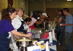 Competing cooks prepare to serve tasters at the Van Geaux cook-off at Aldersgate United Methodist Church in Slidell, La.
