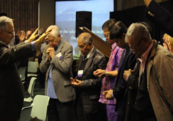 In the wake of Typhoon Haiyan, prayer is offered for bishops from the Philippines during the November 2013 meeting of the United Methodist Council of Bishops.