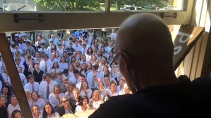 More than 450 students and faculty from a Nashville, TN high school gathered in the backyard of their beloved professor to worship with him and support his battle against cancer. Photo courtesy of Christ Presbyterian Academy.