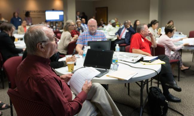 Don Mowery (left) and other members of the General Commission on Communication listen to a report during their meeting at United Methodist Communications in Nashville, Tenn. Photo by Mike DuBose, UMCom.