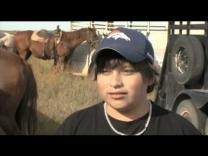 Video image of Native American teen who is part of riding program in North Dakota.