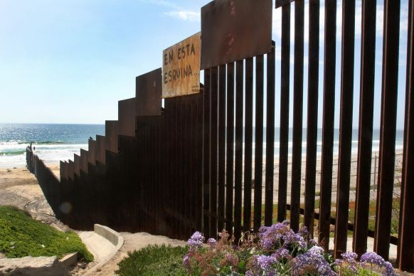 El Faro Park (Mexico side of border) is framed on one side by the U.S. - Mexico wall that separates the two countries and extends out into the Pacific Ocean. A UMNS photo by Kathleen Barry.