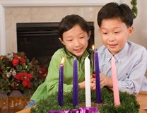 Advent is a time of preparation as children light the second candle of the family Advent wreath. Photo illustration by Ronny Perry, United Methodist Communications.