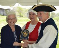 Wendy and Jake Jacobs were presented Saturday with a plaque dedicating Amis House, as a historic site of the United Methodist Church. The plaque was presented by Bishop Mary Virginia Taylor, left. Photo by Jeff Bobo, courtesy Times News Online.